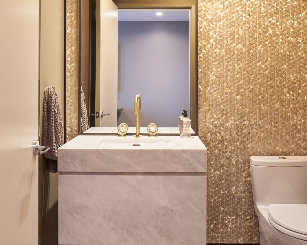 Jewel box powder room with full height mosaic tile feature wall